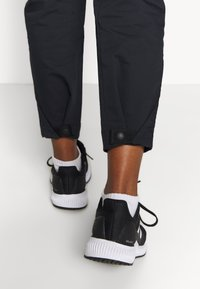 adidas Performance - HIKEREL PANTS - Trousers - black - 4