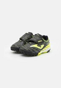 Joma - XPANDER JUNIOR UNISEX - Astro turf trainers - black/yellow - 1