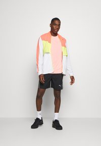 Puma - RUN LITE ULTRA JACKET - Sports jacket - white/energy peach/fizzy yellow - 1