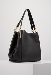 Coach - DALTON SHOULDER BAG - Handbag - gold/black - 3