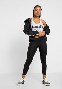 Reebok - WORKOUT READY COMMERCIAL TIGHTS - Leggings - black - 1