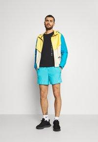 Nike Performance - CHALLENGER SHORT - Sports shorts - chlorine blue - 1