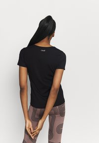Casall - ICONIC TEE - Basic T-shirt - black - 2