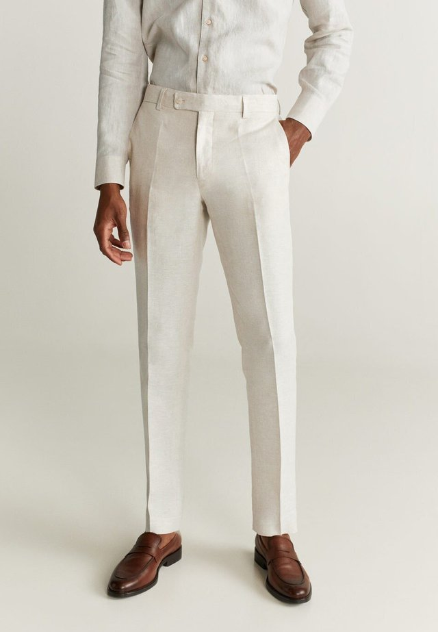 FLORIDA - Suit trousers - ecru