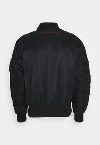 Alpha Industries - Light jacket - black/red - 2