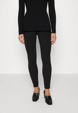 YOKE CORE - Leggings - Trousers - black