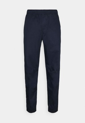 RELAXED CUFFED TRAINER - Trousers - sartho blue