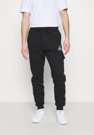 CARGO - Pantalon de survêtement - black