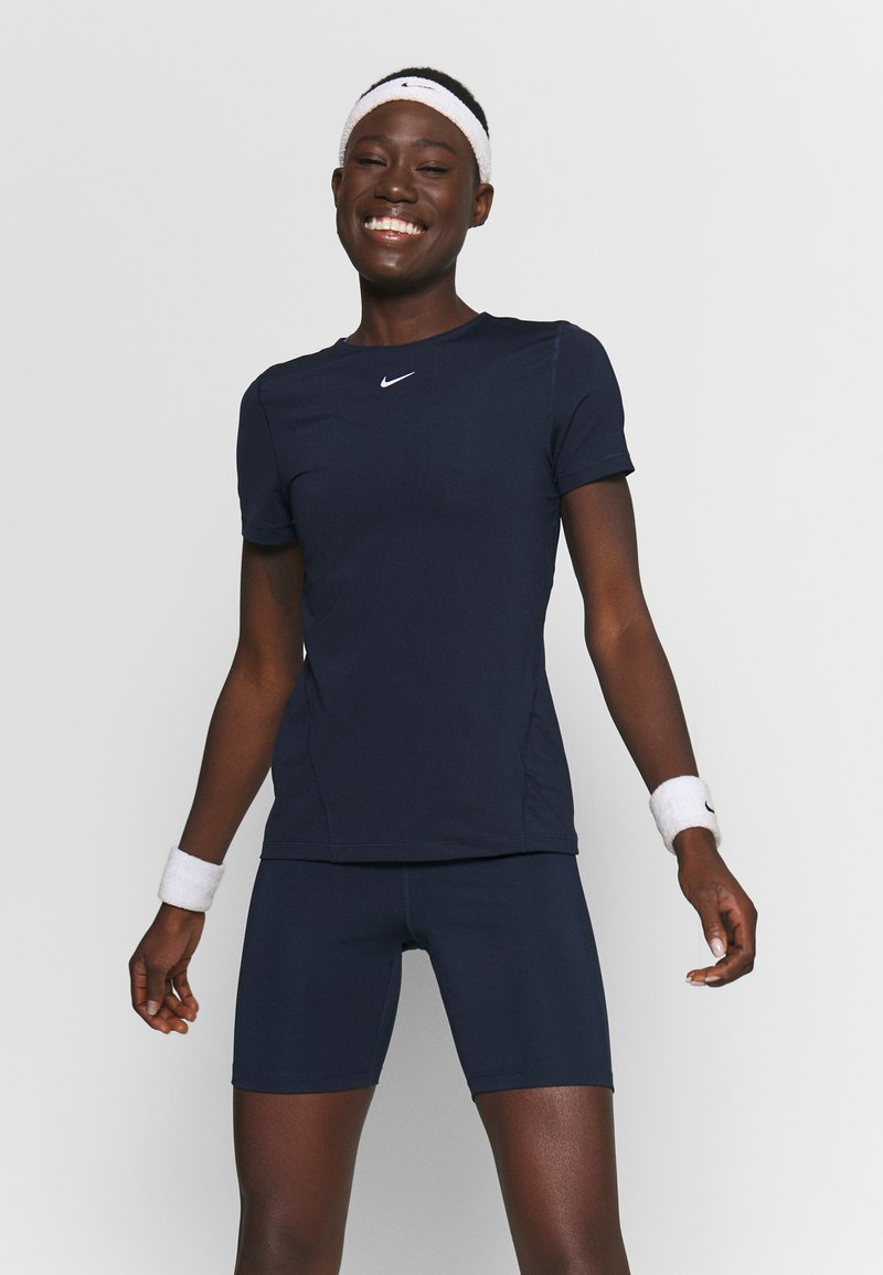 Nike Performance - ALL OVER - T-shirts - obsidian/white