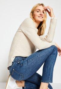 TOM TAILOR - ALEXA - Slim fit jeans - used mid stone blue denim - 4