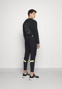 adidas Performance - ULTRA PANT - Trainingsbroek - black/yellow - 2