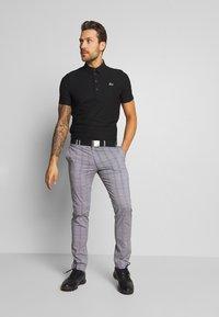 Lacoste Sport - GOLF STRIPE - Sports shirt - black - 1