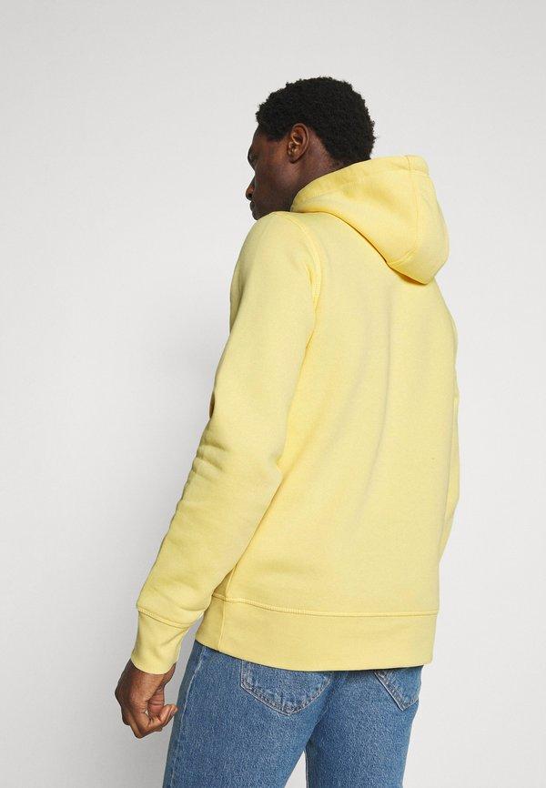 Tommy Hilfiger LOGO HOODY - Bluza z kapturem - delicate yellow/jasnożÓłty Odzież Męska UVIG