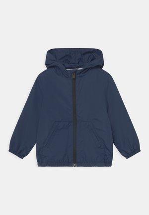RAIN UNISEX - Vodotěsná bunda - navy blue