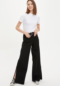 DeFacto - Trousers - black - 4