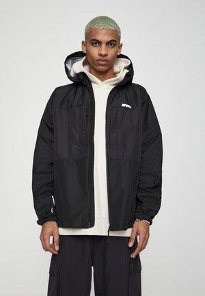 Outdoorová bunda - mottled black