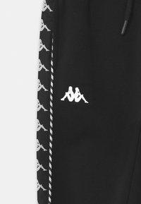 Kappa - IRENEUS UNISEX - Pantalon de survêtement - black - 2