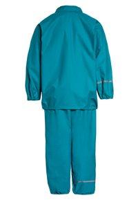 CeLaVi - RAINWEAR SUIT BASIC SET WITH FLEECE LINING - Rain trousers - turquoise - 2