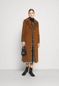 Sand Copenhagen - COAT CLARETA BELT - Classic coat - brown - 1
