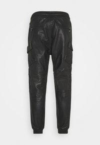 Tigha - RADY - Kožené kalhoty - black - 1