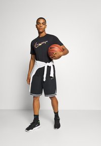 Nike Performance - DRY MEDALLION TEE - Print T-shirt - black - 1