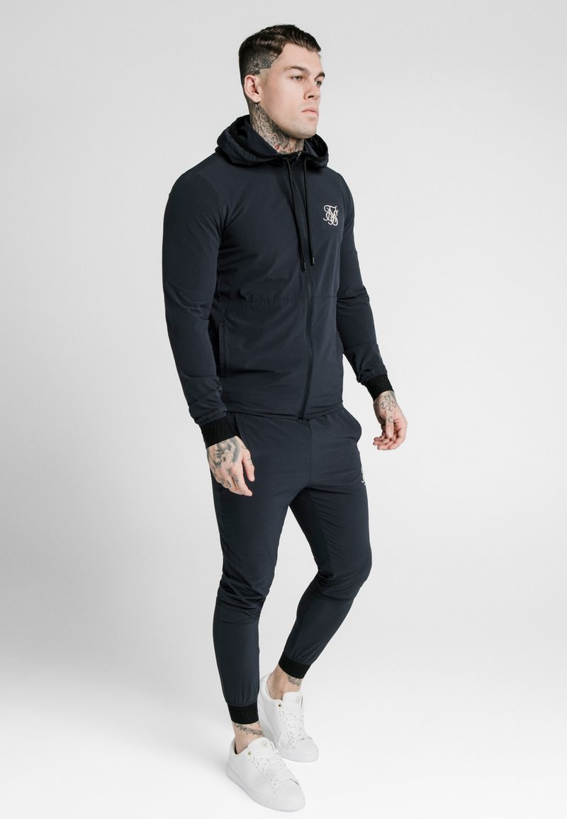 SIKSILK - AGILITY ZIP THROUGH HOODIE - Lehká bunda - midnight navy