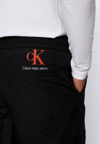 Calvin Klein Jeans - SEAMED PANT - Trousers - black - 5