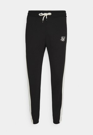 PREMIUM TAPE TRACK PANT - Tracksuit bottoms - jet black/offwhite