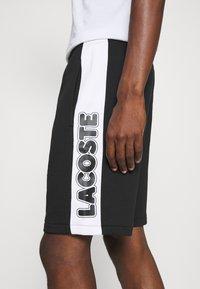 Lacoste - Pantaloni sportivi - noir/blanc - 5