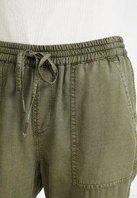 Opus - MUNDINI - Trousers - oliv green - 6