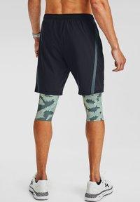 Under Armour - 2-IN-1 - Sports shorts - lichen blue - 2