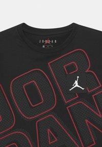 Jordan - JORDAN NEXT UTILITY - T-shirt con stampa - black - 2