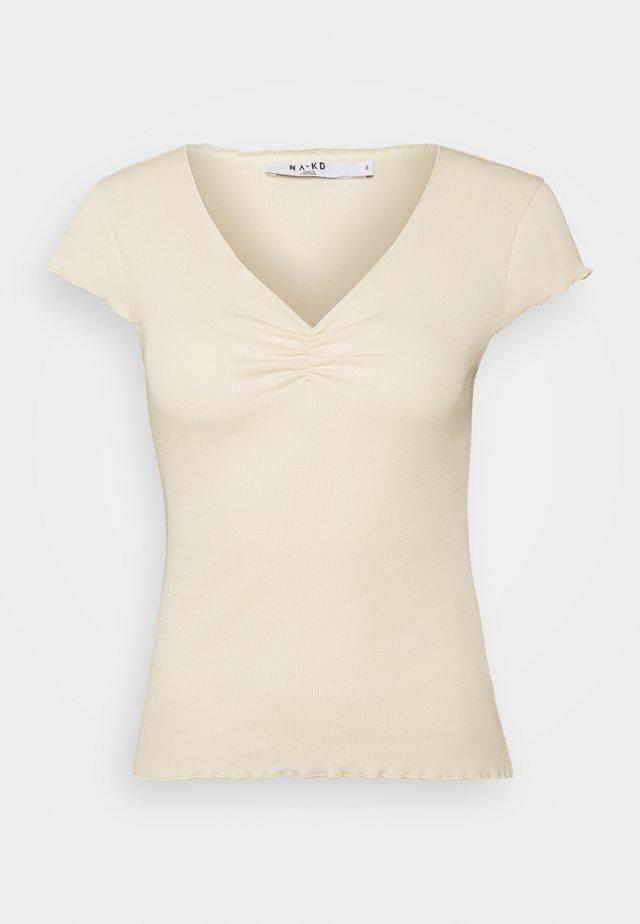 LETTUCE HEM - T-shirt med print - beige