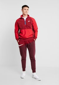 Nike Sportswear - WINTER - Fleece trui - team red/gym red/lt photo blue/white - 1