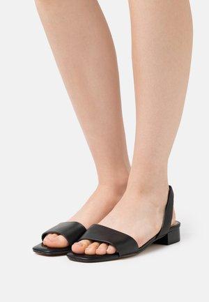 DOREDDA - Sandals - black