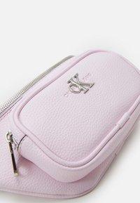 Calvin Klein Jeans - CONVERTIBLE WAIST BAG - Bum bag - pink - 4