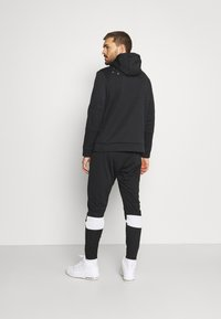 Jordan - AIR PANT - Verryttelyhousut - black/white - 2