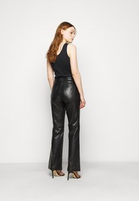 STUDIO ID - AMBER  - Leather trousers - black - 2
