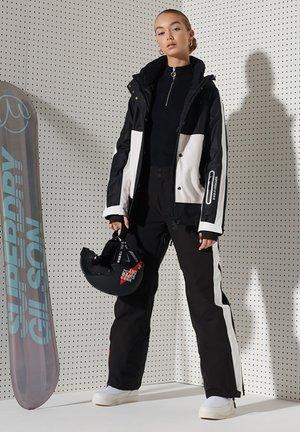 FREESTYLE ATTACK - Ski jacket - black