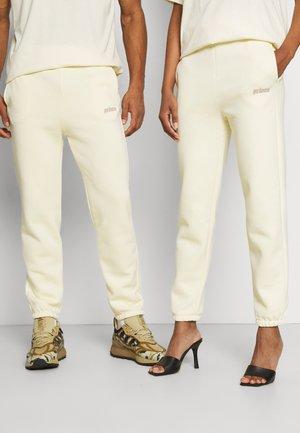 LOGO JOGGER UNISEX - Teplákové kalhoty - cream