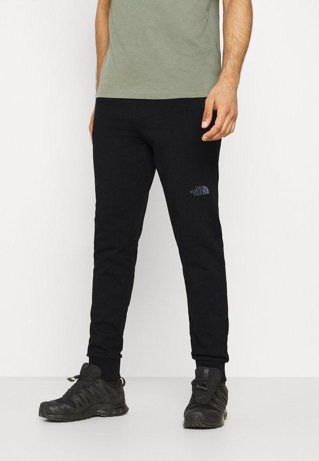 LIGHT PANT WROUGHT IRON - Pantalon de survêtement - black