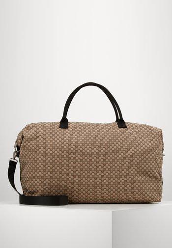TRAVEL WEEKEND BAG - Weekend bag - beige/black