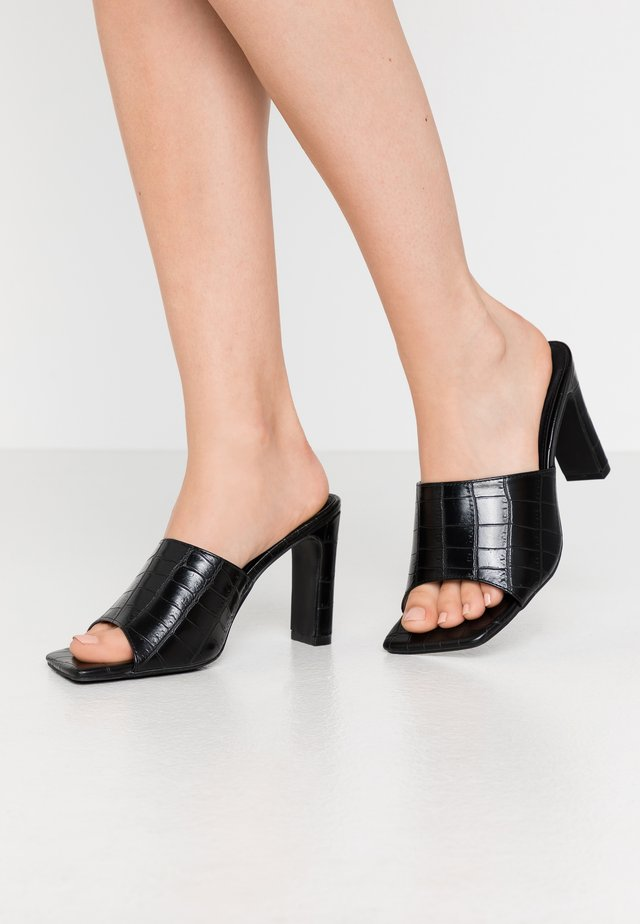 ARLO - Heeled mules - black