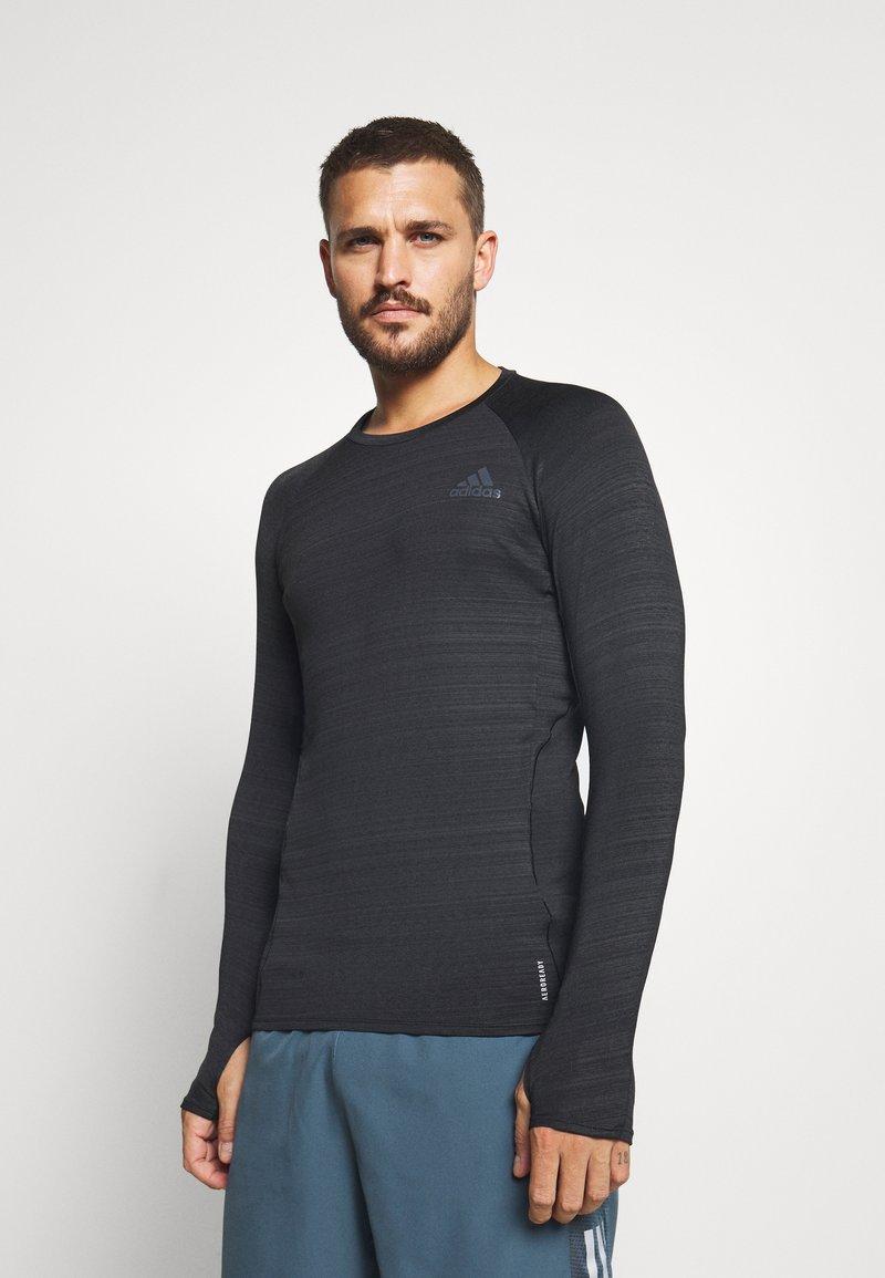 adidas Performance - RUNNER - Camiseta de deporte - black