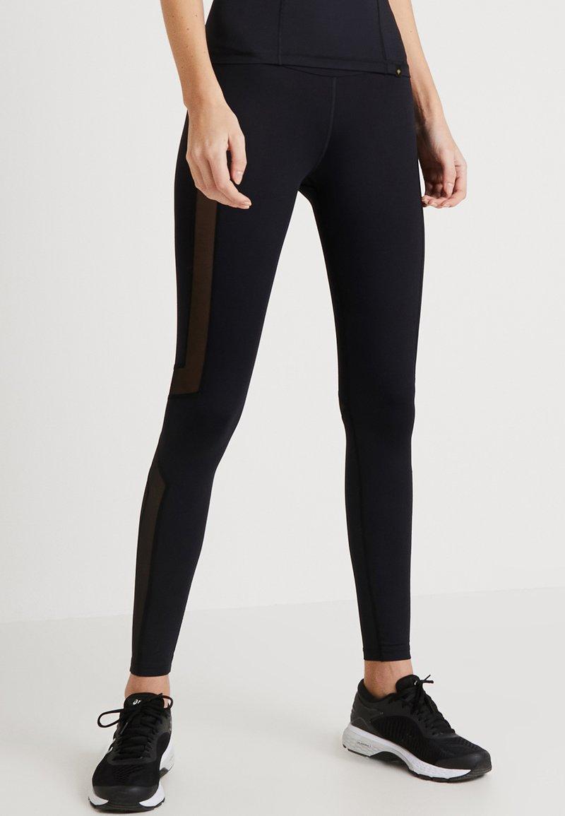 Daquïni - FLUXUS - Leggings - Trousers - black