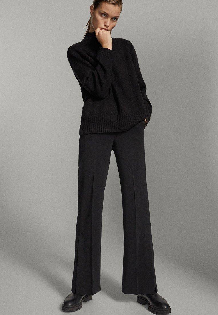 Massimo Dutti - SCHWARZE MIT SCHLITZ AM SAUM  - Pantalon classique - black