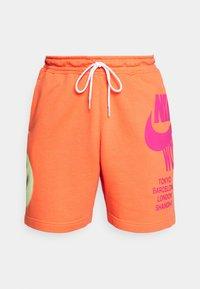 Tracksuit bottoms - turf orange