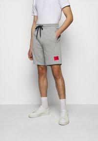 HUGO - Tracksuit bottoms - medium grey - 0