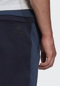 adidas Performance - Z.N.E. SPORTSWEAR PRIMEGREEN PANTS - Pantalon de survêtement - blue - 5
