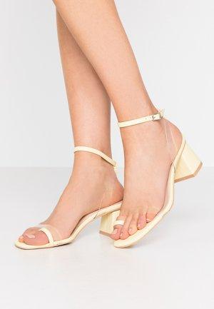 ZENON - T-bar sandals - clear/yellow